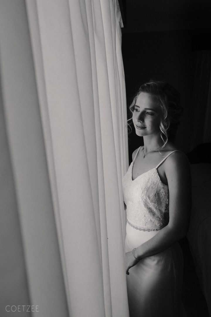 monochrome bride looking out window
