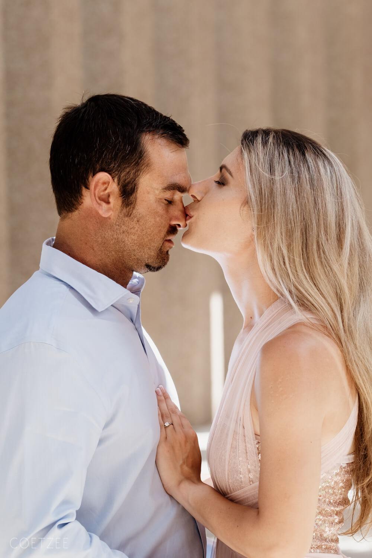 romantic engagement couple kiss nose
