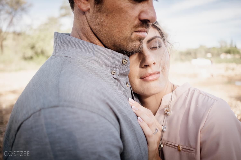 romantic engagement man woman intimate hug