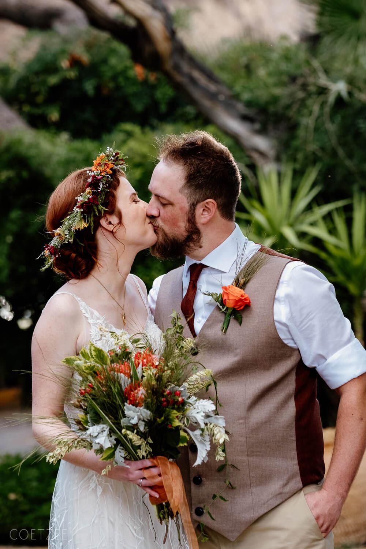 bridal couple kiss